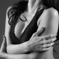 woman embracing her breasts