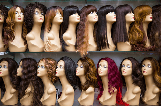 various long wigs on display