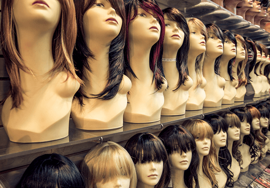 various wigs on display