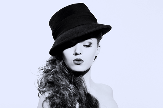 woman wearing black hat posing