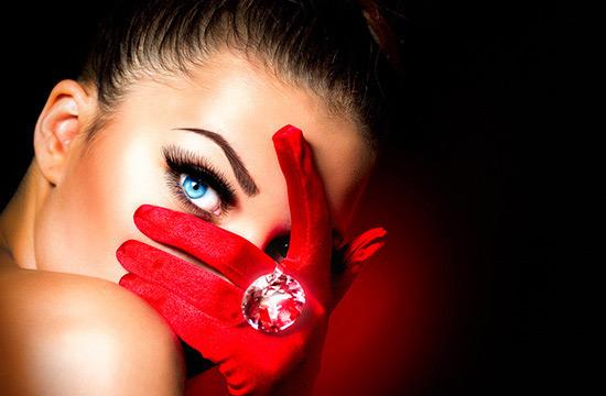 eye peeking through gloved hand