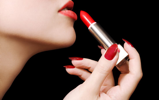 applying red lipstick