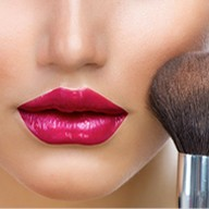 pouting lips and makeup brush