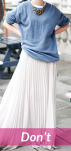white flowing skirt and loose shirt