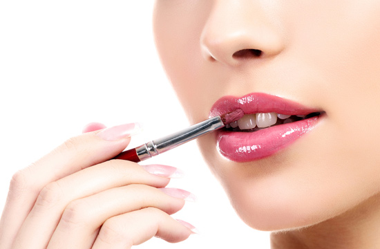 applying lipstick using brush