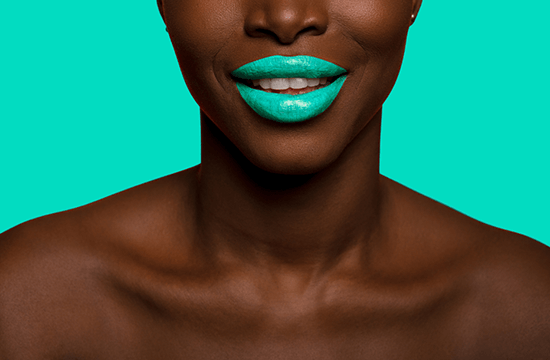 woman wearing teal colored lipstick