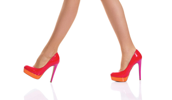 walking in red orange heels