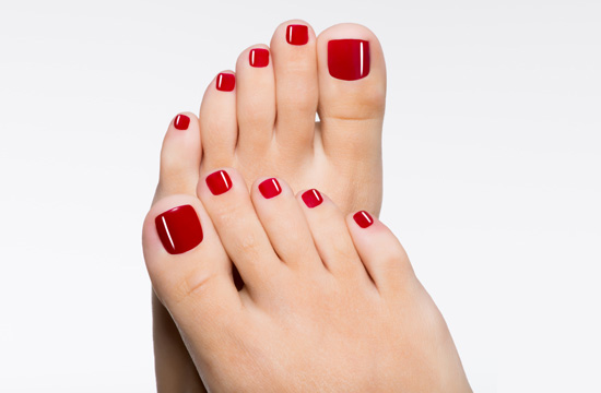 groomed feet and red nails