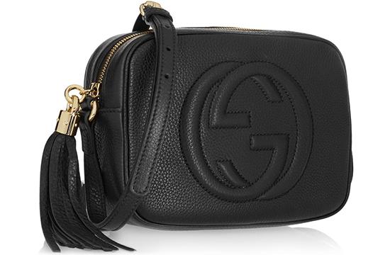black Gucci bag with tassel