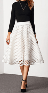 white A line skirt and black fit blouse