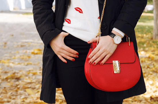 red handbag with gold embellishment