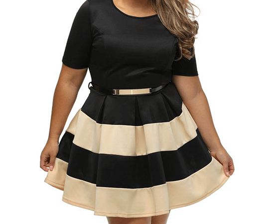woman in black and beige dress