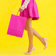 lady in pink skirt with pink shopping bag