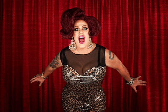 diva in front of red curtain