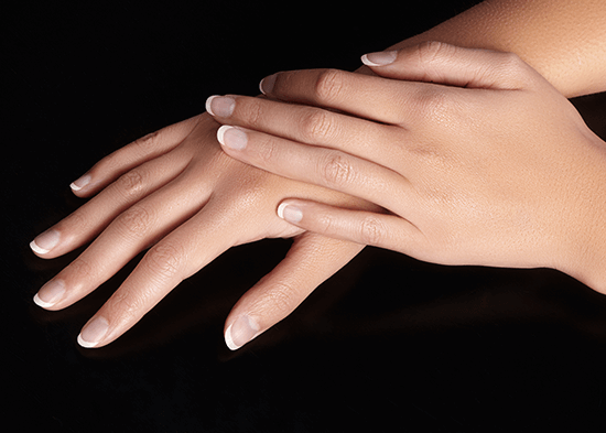 hands with manicured french nails