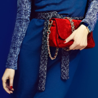 woman holding a red bag