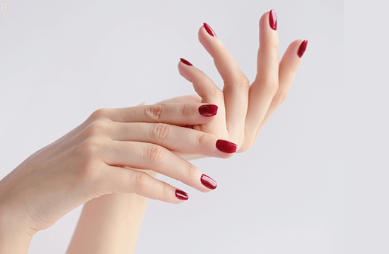 hands with manicured red nails