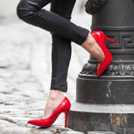woman wearing red heels and black pants