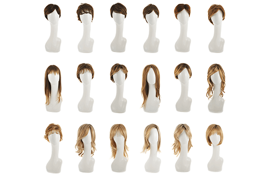 an assortment of styled wigs