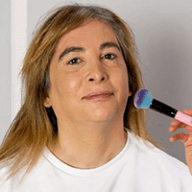 Transwoman putting on makeup
