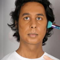 transwoman applying makeup